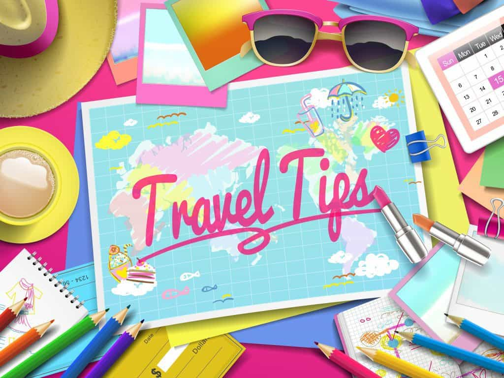 Travel Tips on the map, top view of colorful travel essentials on the table. Cruising Tips